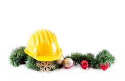 Konstruktionshjälm och jul arkivfoton