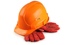 Konstruktionshjälm och skyddande handskar Arkivbild