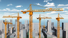 Konstruktionskranar i ett stadslandskap Arkivbild