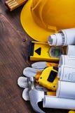 Konstruktionsplan och grupp av byggnadshjälpmedel på Arkivfoto