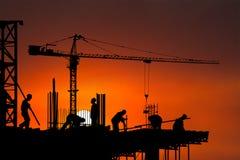 Konstruktionsplats, arbetare, arbetare, bakgrund Fotografering för Bildbyråer