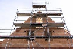 Konstruktionsplats av ett nytt byggt hus arkivfoto