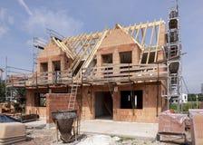 Konstruktionsplats av ett nytt byggt hus royaltyfri foto
