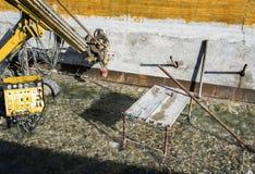 Konstruktionsplats, konstruktionsmaskineri Arkivbild