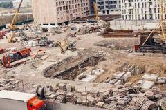 Konstruktionsplats, konstruktionsmaskineri, bulldozer, utgrävning Arkivbild