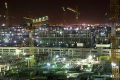 Konstruktionsplats på natten. Doha Arkivbilder