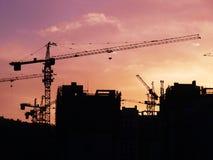 Konstruktionsplats på solnedgång Royaltyfri Fotografi