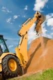 konstruktionsutgrävningladdare Arkivbild