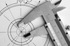 Konstruktionszeichnung und -schieber Stockfotografie