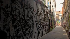 Konstverksikt på grafittigatan royaltyfria foton
