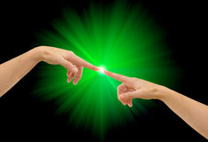 kontakten hands två Arkivfoto