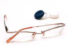 Kontaktlinsen oder Gläser   Stockbild