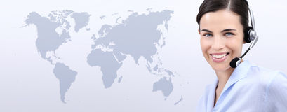 Kontaktuje się my, obsługa klienta operatora kobieta z słuchawki ono uśmiecha się Fotografia Stock