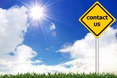 Kontaktuje się my na drogowym znaku ostrzegawczy Obraz Royalty Free