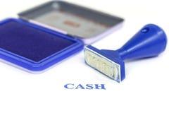 Kontant bokstav på blå rubber stämpel Royaltyfria Foton