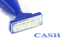 Kontant bokstav på blå rubber stämpel Arkivfoton
