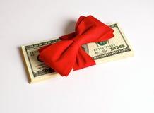 Kontant bonus som gåvan för jul Fotografering för Bildbyråer