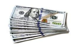 Kontanta amerikanska dollar med räkningar för dollar $100 hundra Arkivbild
