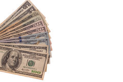 Kontanta amerikanska dollar på en vit bakgrund Arkivfoto