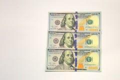 Kontanta pengar mönstrar oss dollar Arkivfoton