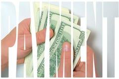 Kontanta US dollar i hand Arkivbild