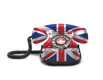 Kontor: gammal och tappningtelefon med flaggan för facklig stålar Arkivbild