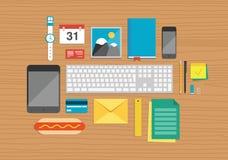 Kontorsbeståndsdelar på skrivbords- illustration Arkivfoto