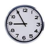 Kontorsklockan visar fem till nio Royaltyfri Foto