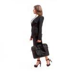 Kontorskvinna med portföljen Fotografering för Bildbyråer