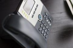 Kontorstelefon på skrivbordet Royaltyfria Foton