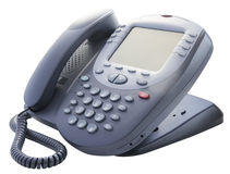 Kontorstelefon på vit Arkivbild