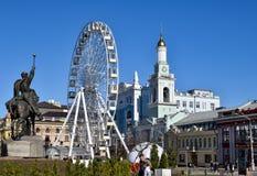Ferrie`s Wheel on Kontrakova square. Kontraktova Square is a main square in Podil. Historical part of city royalty free stock images