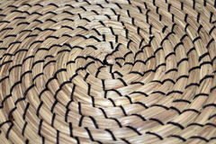 Kontrastieren der spiralförmig gebildeten Grasmatte Stockfotografie