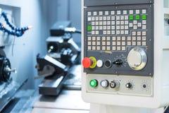 Kontrollbord av den moderna drejbänken industriell abstrakt bakgrund Fotografering för Bildbyråer