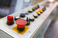 Kontrollbord med den röda startknappen i fokus Royaltyfri Fotografi