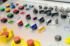 Kontrollbord med knappar, tangent och strömbrytaren royaltyfria foton