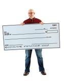 Kontrolle: Netter Guy With Huge Check lizenzfreie stockfotografie