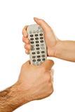 kontrollera händer som rymmer remoten arkivbilder