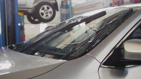Kontrollera i seminariet - arbetande torkare av bilen, glidareskott Royaltyfri Fotografi