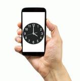 Kontrollera tiden med min smartphone Fotografering för Bildbyråer