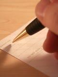 kontrollera underteckning Arkivbilder