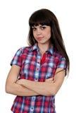 kontrollerad skjorta för flickaståendered Arkivbild