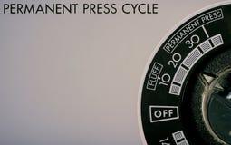 Kontrollknopp på en tvagningmaskin och tork arkivfoton