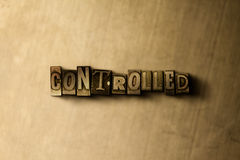 KONTROLOWANY - zakończenie grungy rocznik typeset słowo na metalu tle zdjęcia stock