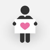 Kontur av en man med ett tecken med rosa hjärta Arkivbilder