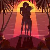 Kontur av ett par som beundrar solnedgången Royaltyfria Bilder