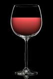 Kontur av färgrikt vinexponeringsglas på svart Royaltyfria Foton