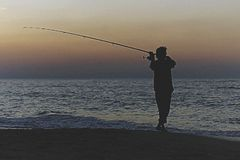 Kontur av fiskaren arkivfoton