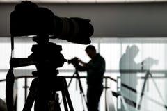 Kontur av fotografen och kameraman Arkivfoto
