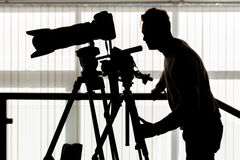 Kontur av fotografen och kameraman Arkivbild